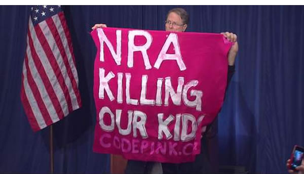 Anti-NRA-protests-NRA-killing-our-kids-banner